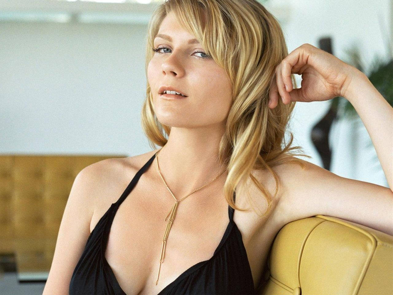 "Kirsten Dunst and her barely visible ""snaggletooth."" You ARE looking ... Anna Paquin"