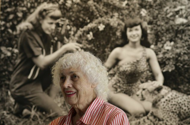 Most recent photo of Bunny Yeager. Background is a photo of her and Bette Page