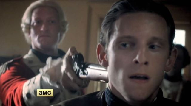 Rat fink Simcoe holding gun to the head of spy Abraham Woodhull, (Jamie Bell)