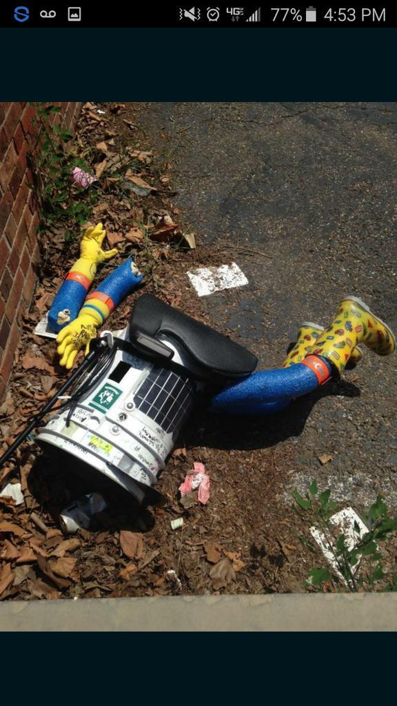 "The dismembered body of ""hitchBOT"" the robot"